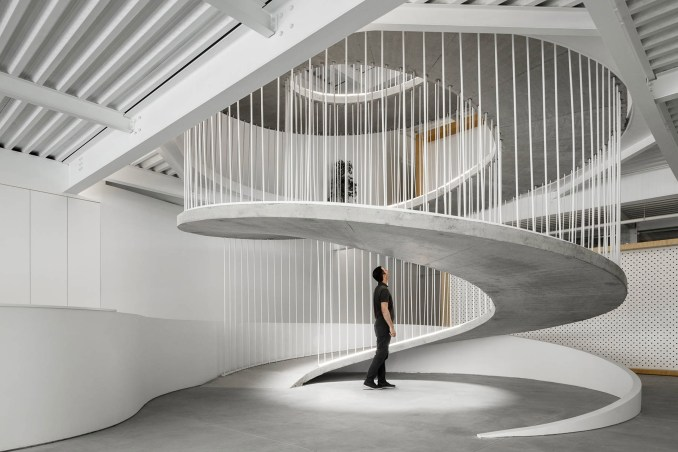 Base of spiralling concrete ramp in E-goi and Clavel's Kitchen by Paulo Merlini Architects
