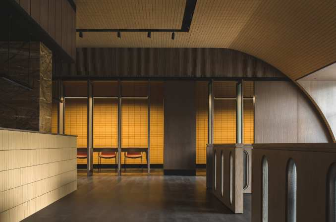 Buda Hotel lobby with counter and curved ceiling clad in yellow tiles