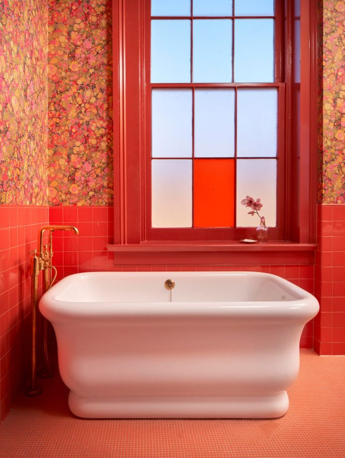 Bright red guest bathroom
