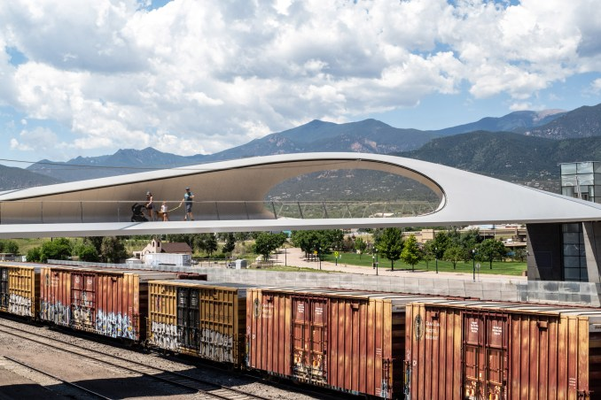 Steel bridge by Diller Scofidio + Renfro over a railway line in Colorado Springs
