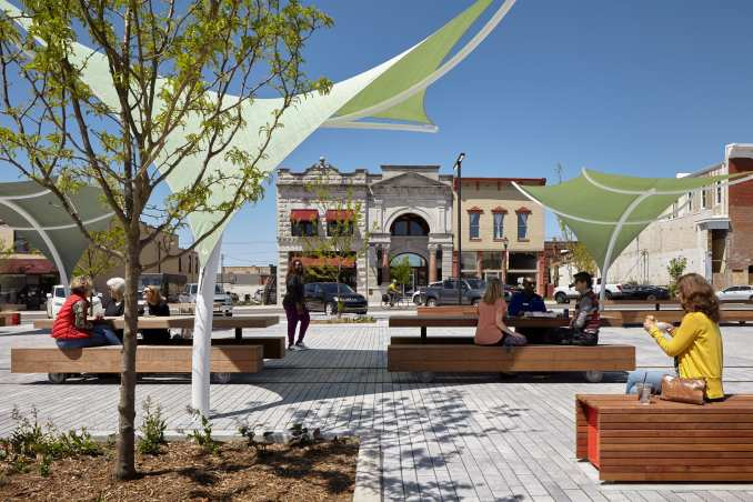 Picnic tables at a plaza in a park designed by Ross Barney Architects