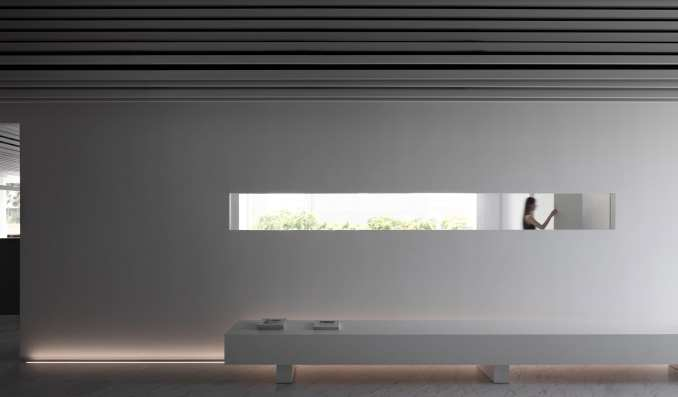 a window looks into neighbouring rooms at Runxuan textile office