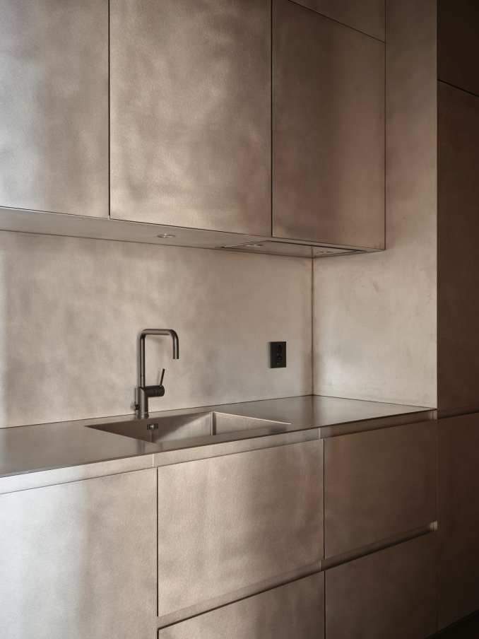 Cabinetry at samsen atelier was finished with a silver hue