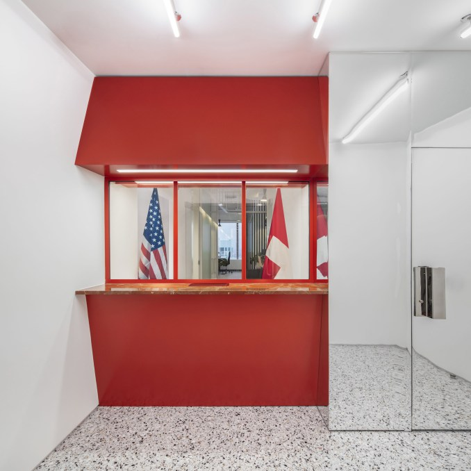 Reception booth and chrome door of Swiss Consulate in Chicago
