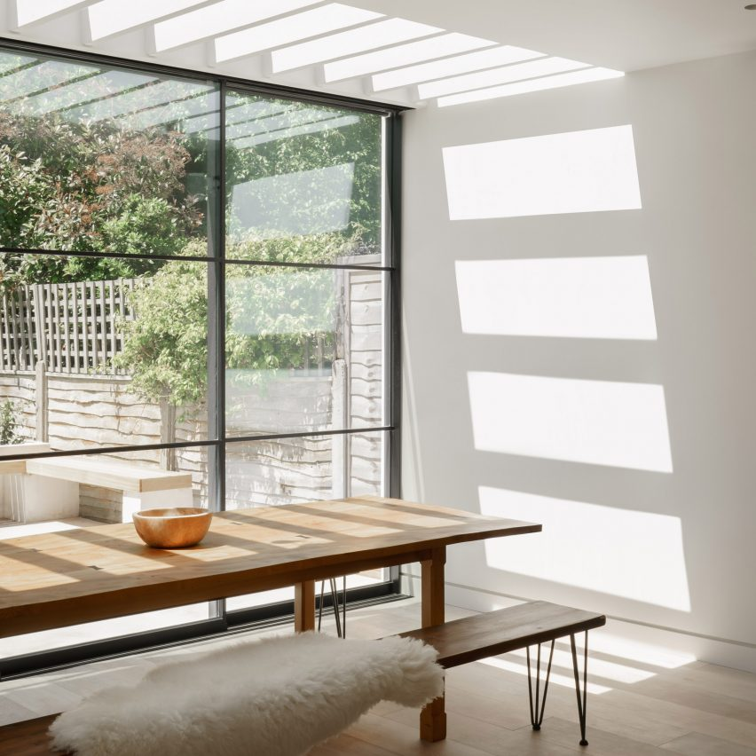 Kitchen and dining room extension with skylight in T-House by Will Gamble Architects