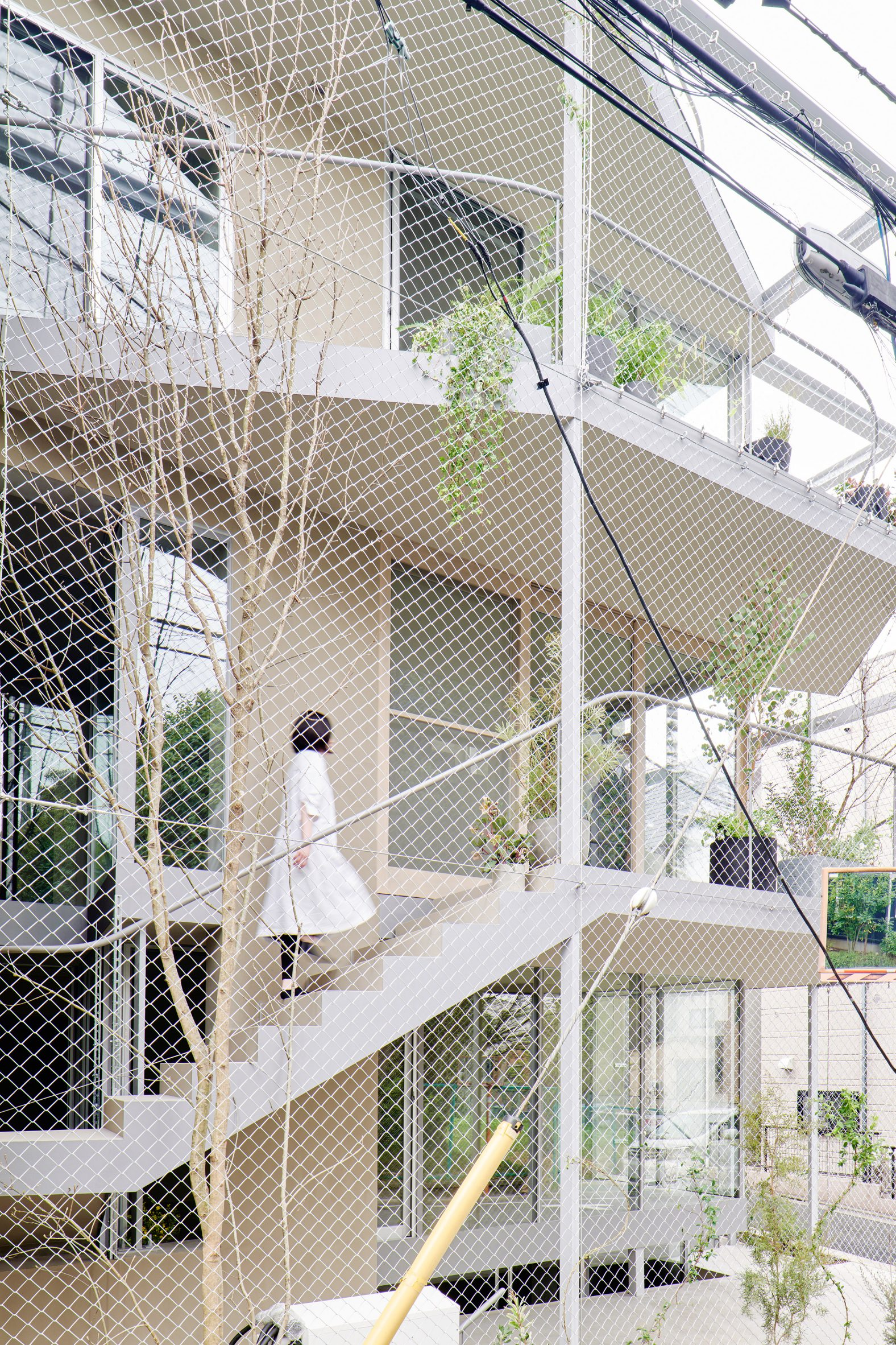 A house covered in metal mesh