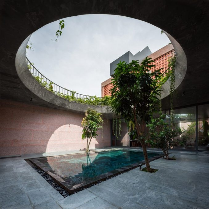 Circular opening above a pool at pink house