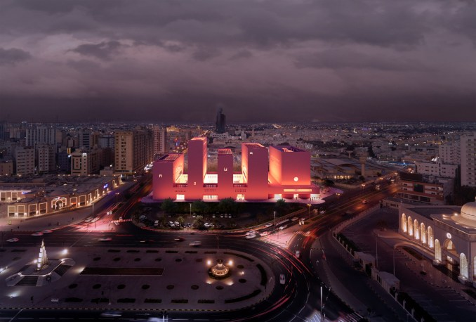 A red-hued concrete building in Sharjah