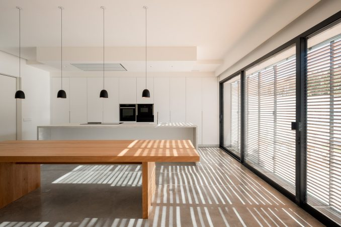 Light filters through the shutters at alaro house