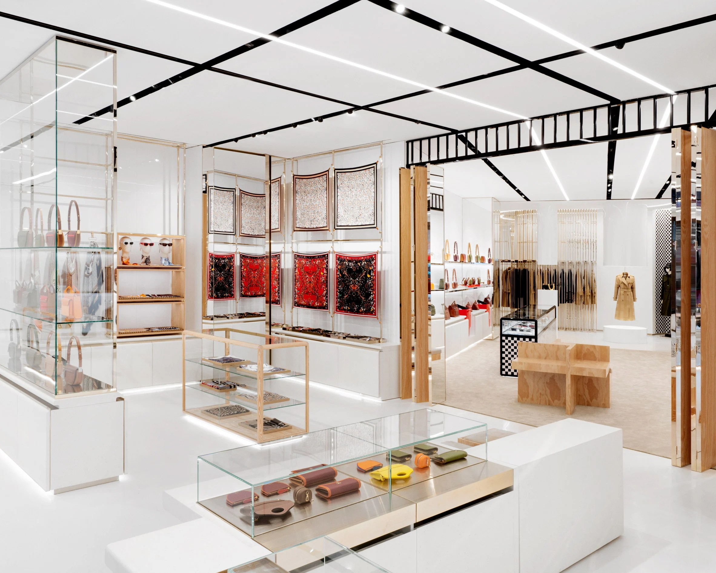 No.1 Sloane Street store by Vincenzo De Cotiis with accessories displayed in champagne-coloured steel units