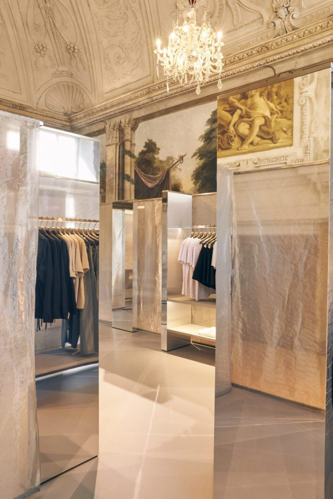 Mirrored displays with mesh curtains in store