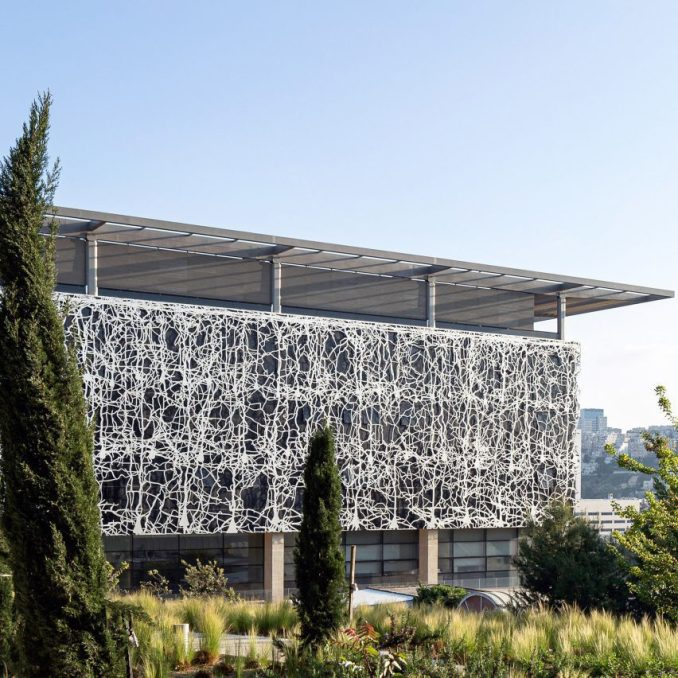 A building clad with metal screens