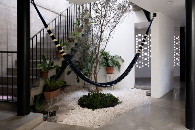 Gestalt Associates added potted plants to the house