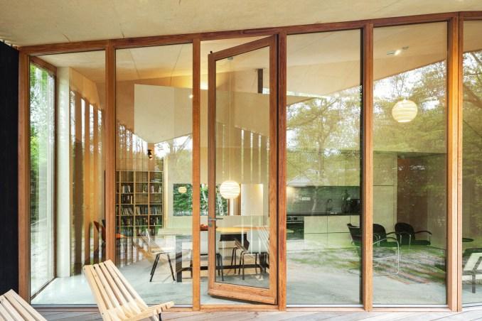 Floor to ceiling glass sliding doors run along the cabin