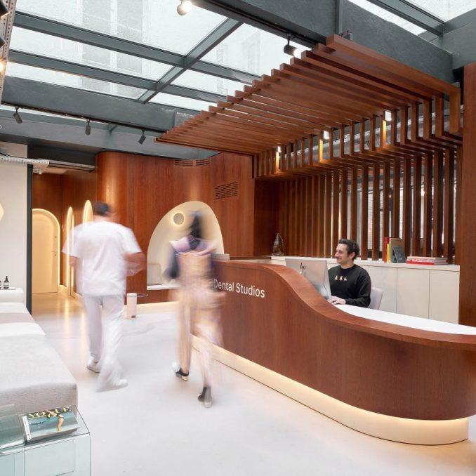 A customer entering a dentist studio reception