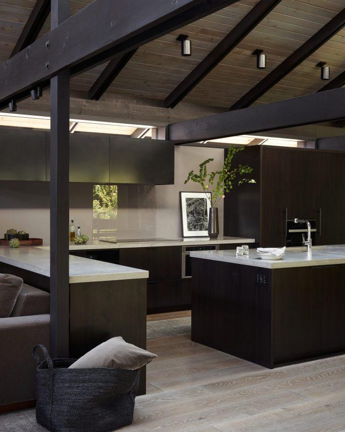 The kitchen has light grey countertops