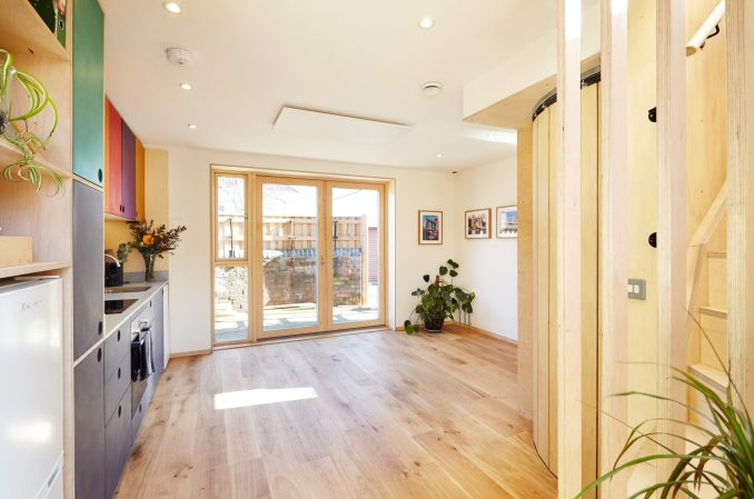 A photograph of a kitchen with wooden flooring