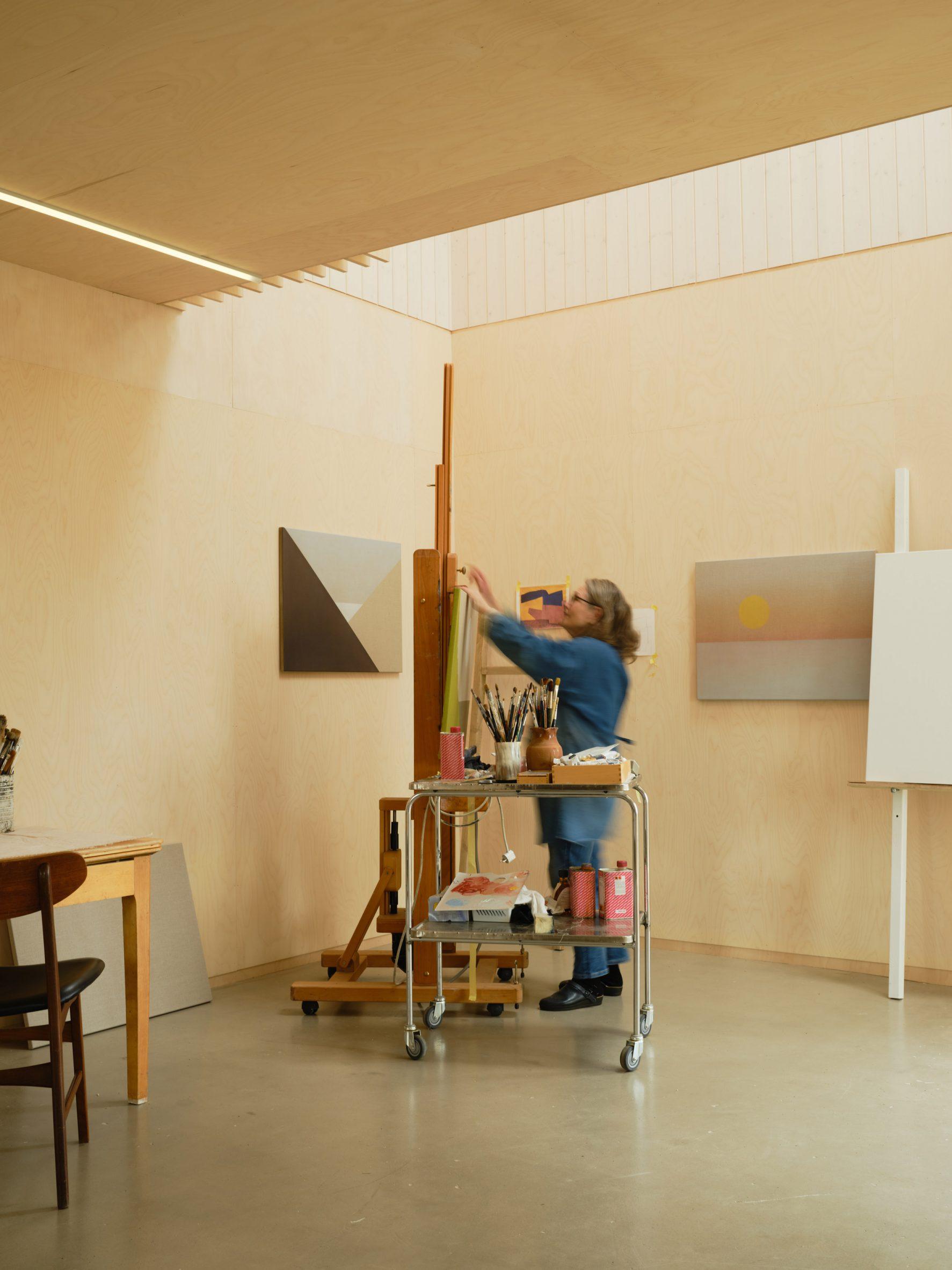 A wood-lined artist studio