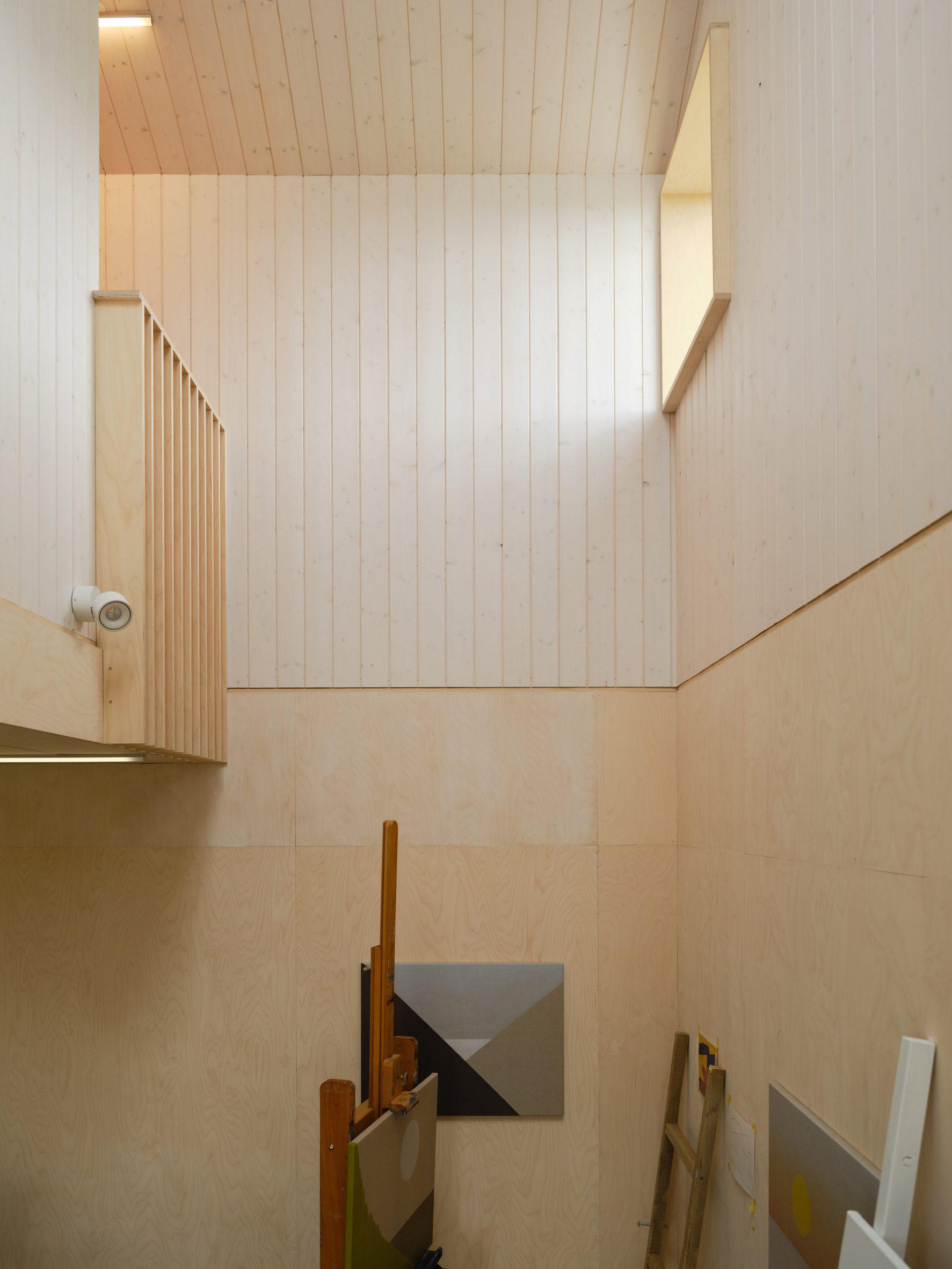 A wood-lined studio inside an Icelandic home