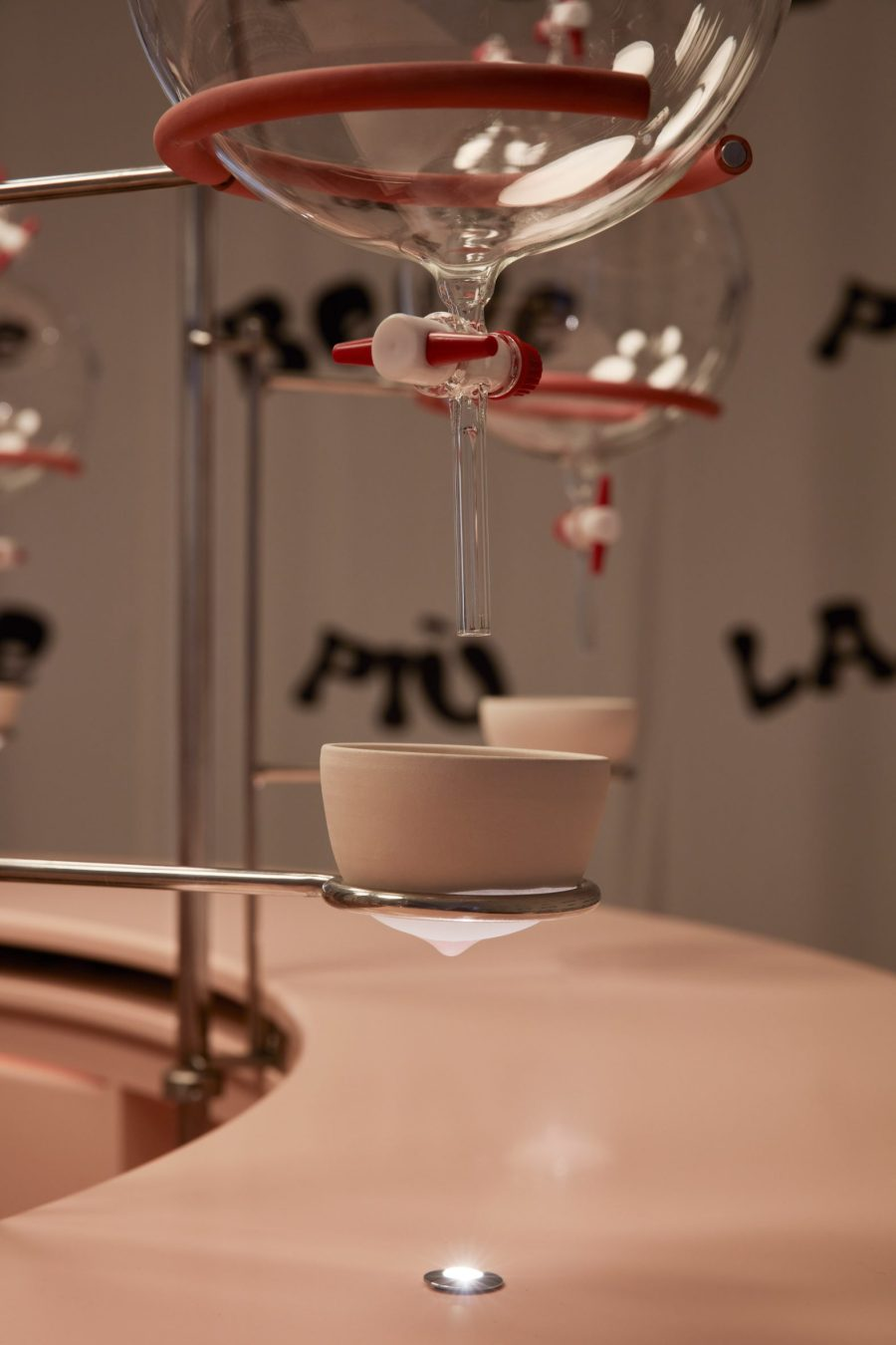 Breast shaped ceramic cup with nipple in a metal holder from Clockwork Orange milk bar installation