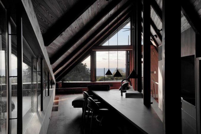 A triangular bar in the kitchen opens out to the living space