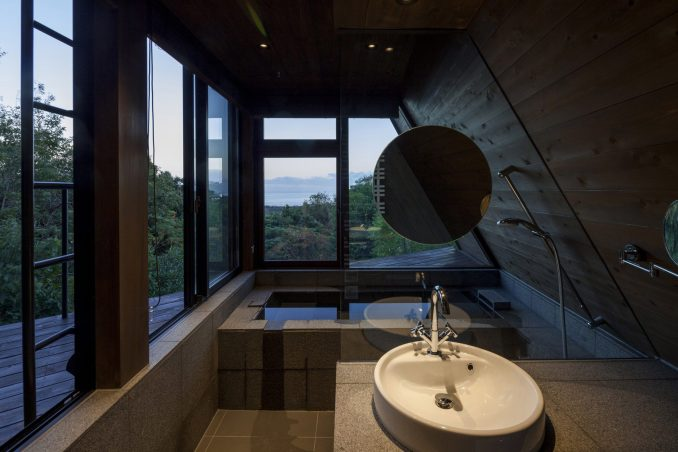The bathroom is enveloped by windows