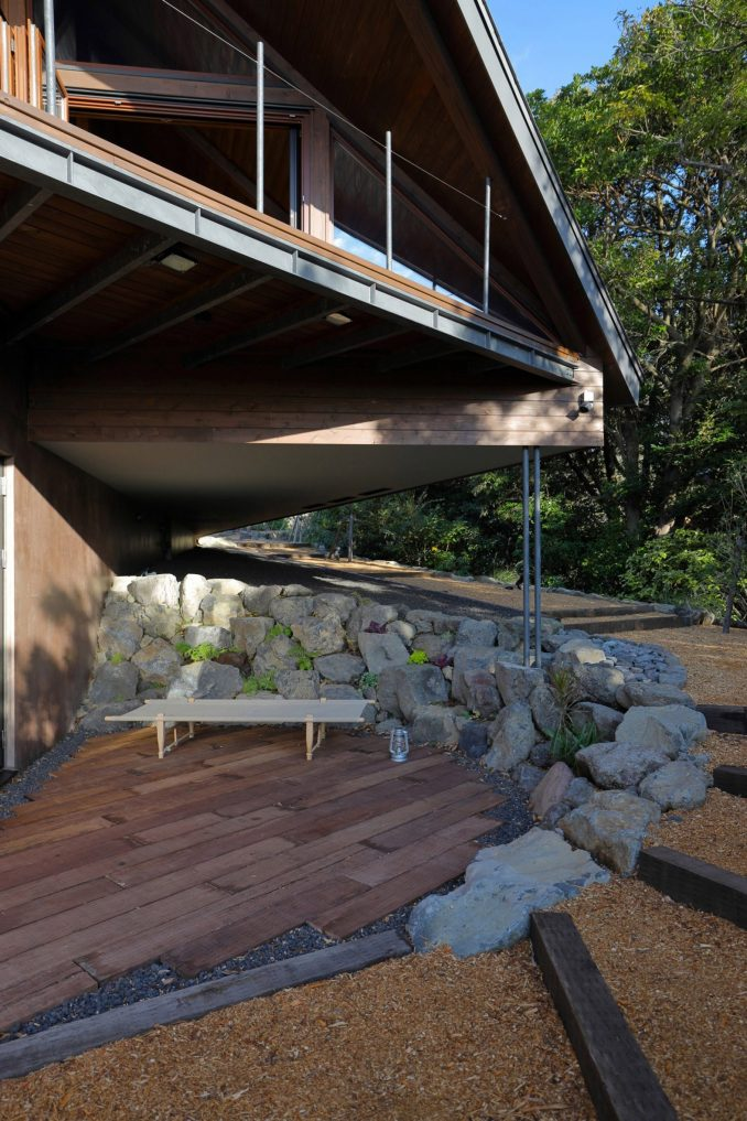 A deck surrounded by rocks is located beneath the overhang at Setoyama