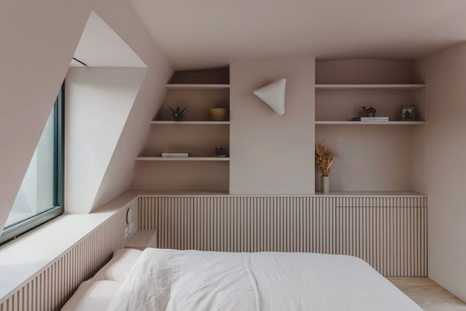 Bed and window in Narford Road loft extension by Emil Eve Architects