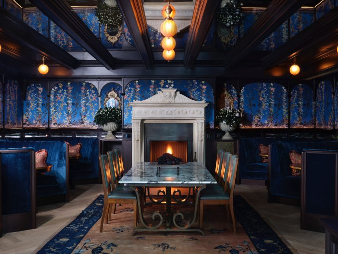 Dining room in NoMad London with blue silk wall coverings