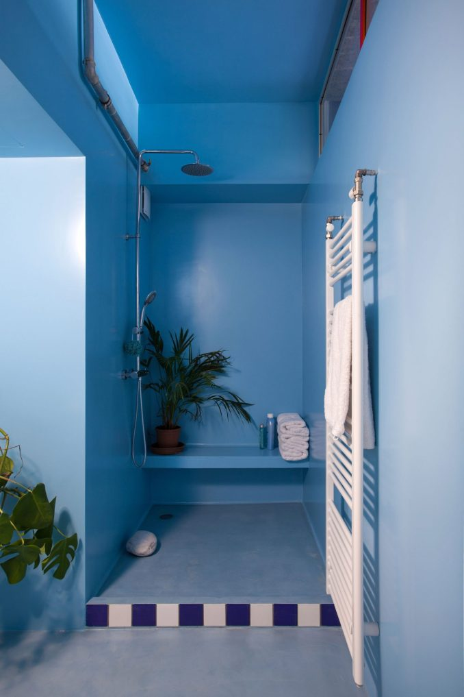 Point Supreme added blue accents to the bathroom