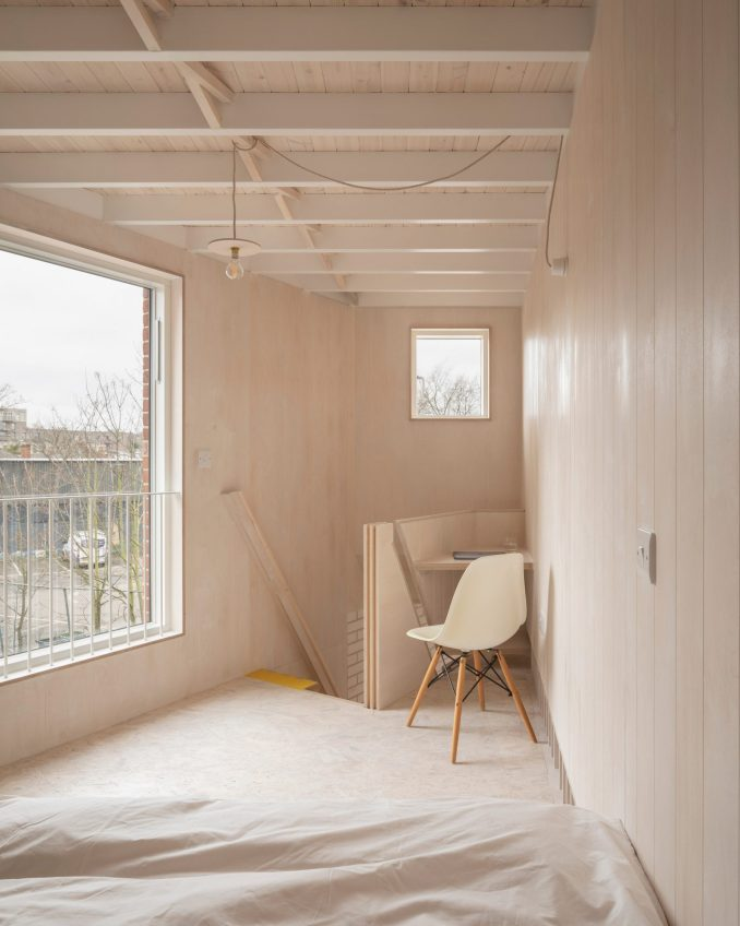 Apartment mezzanine with corner desk in The Queen of Catford by Tsuruta Architects
