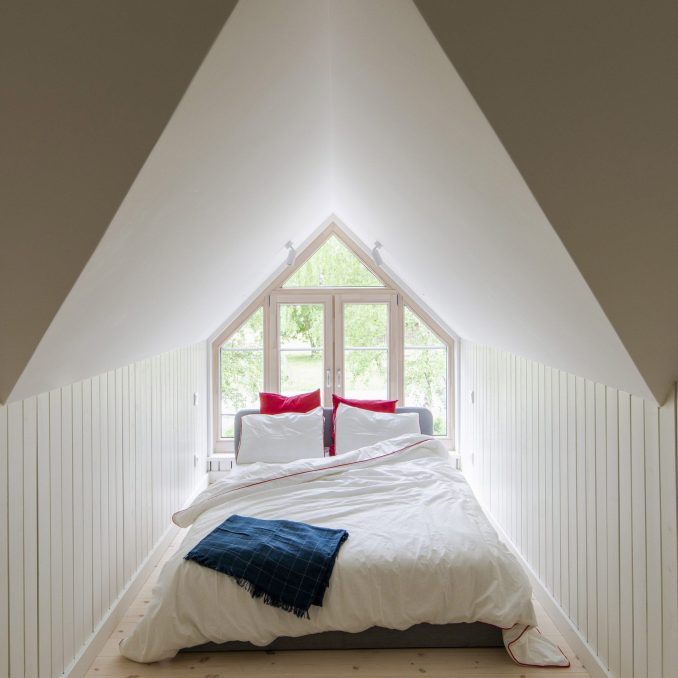 A bed was put within a triangular space