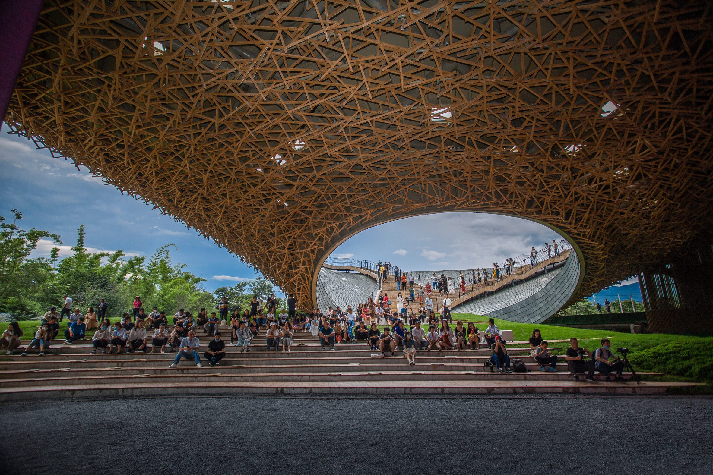 A plaza is located beneath the Yang Liping Performing Arts Center's slate roof