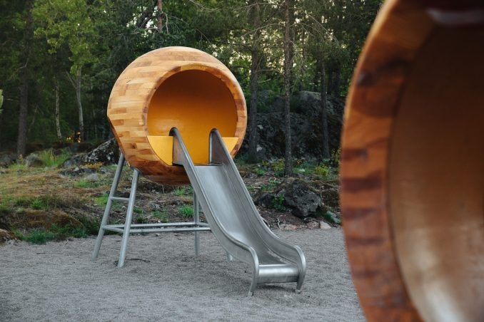A wooden sphere with a metal slide