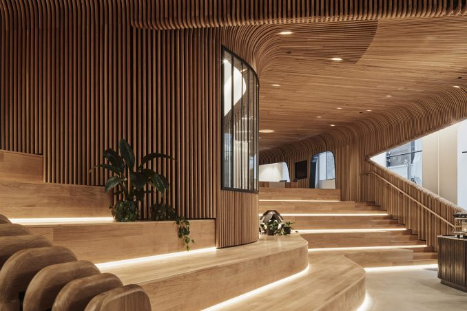 Wooden steps for sitting in Melbourne retail interior by Woods Bagot