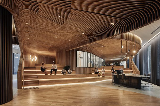 Wooden amphitheatre in Melbourne retail interior by Woods Bagot