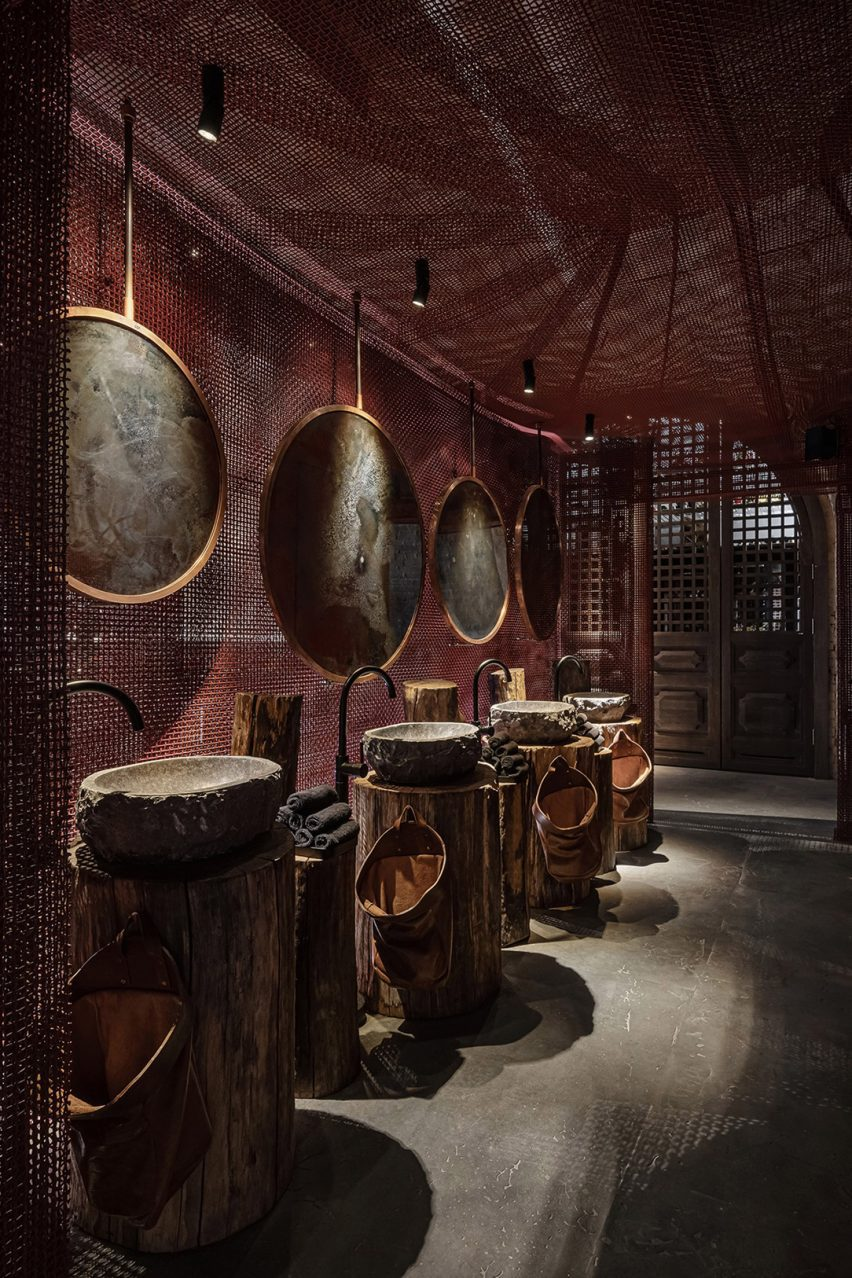 Mesh lines the ceiling and walls of the bathrooms at Virgin Izakaya Bar