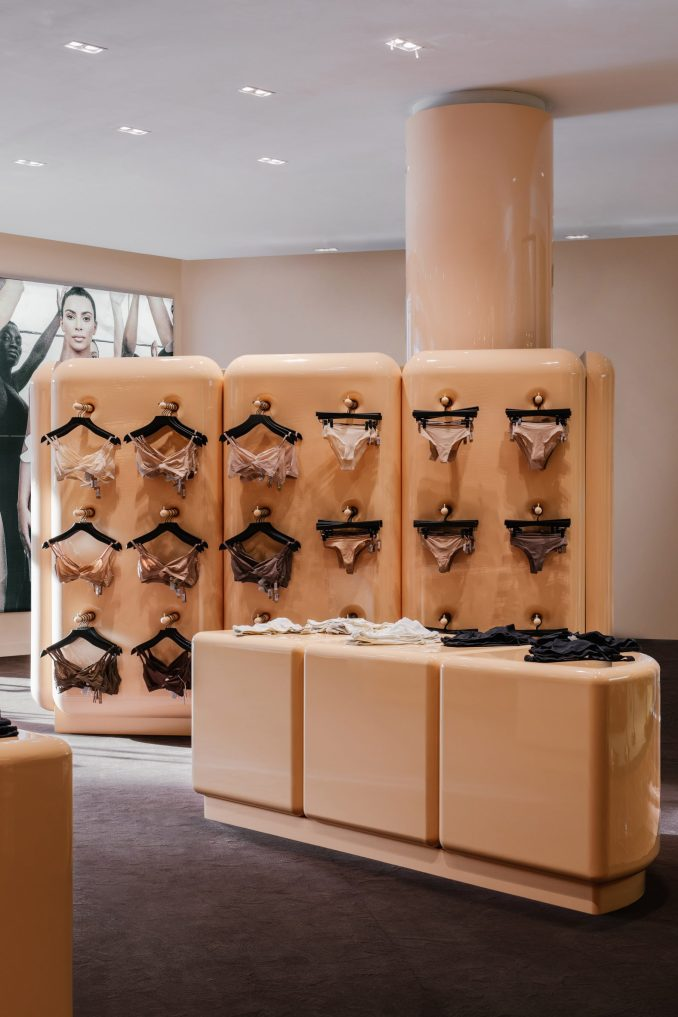 Underwear displayed on hangers and on counters in the SKIMS store