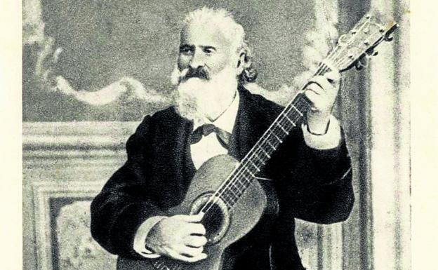One of the best known images of Iparragirre with his inseparable guitar.