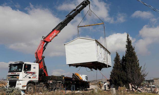 Illegale Siedlungen werden geräumt. – APA/AFP/THOMAS COEX