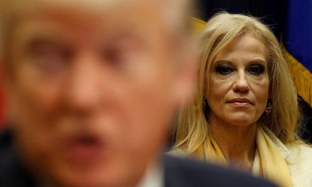White House advisor Conway listens as President Trump meets with county sheriffs at the White House in Washington