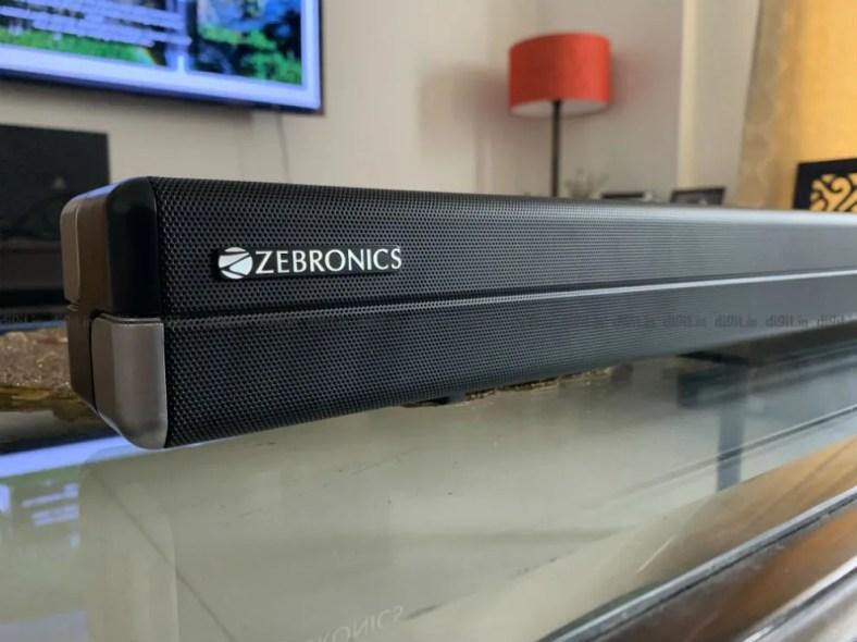 The soundbar has the Zebronics logo on the left