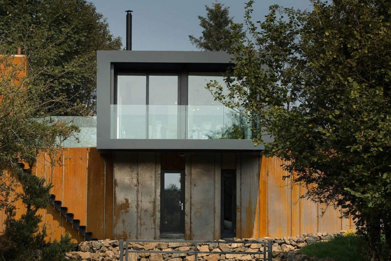 Architect  Patrick Bradley chose to use cargo containers for the house located on his farm in Northern Ireland, as a way to bring down the cost.