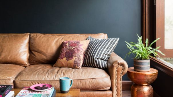 """Darker tones are becoming increasingly popular for a home's """"quiet"""" areas."""
