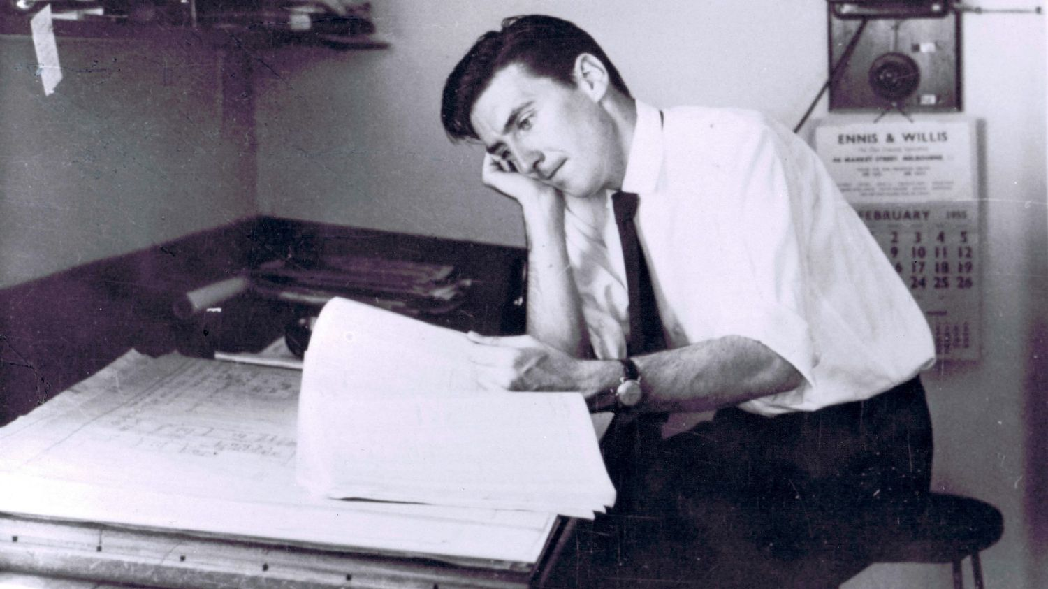 Peter McIntyre at the drawing board in the 1950s.
