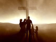 Family at the Cross of Jesus Christ Stock Photo