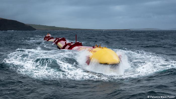 The vast, worm-like Pelamis Wave Power energy converter at sea and riding the waves.