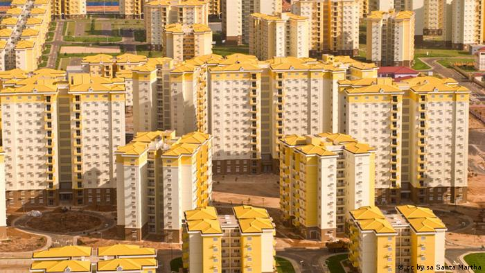 Yellow and white Nova Cide de Kilamba buildings from afar