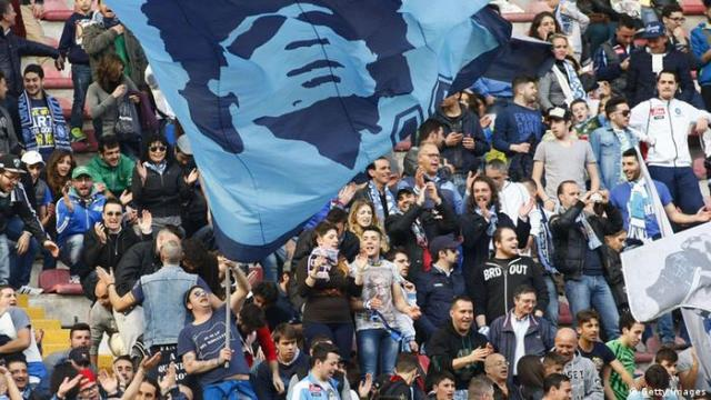 Napoli fans with a Maradona banner
