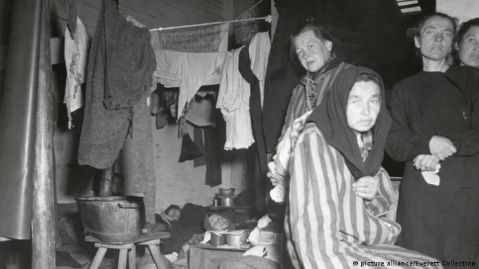 Women who survived the Holocaust living in makeshift conditions in 1945 in the displaced persons' camp on the site of the former Bergen-Belsen concentration camp